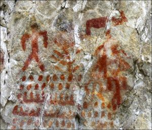 Rock painting of a humans, animals and possibly canoes (by The Siberian Times)