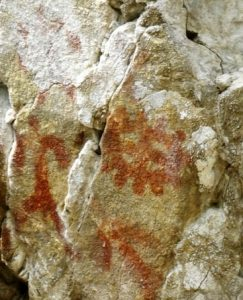 Rock painting of a human and a solar sign (by The Siberian Times)