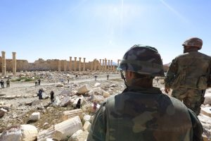 Soldiers look over damage at the historical Bel Temple in Palmyra (by Voice of America)