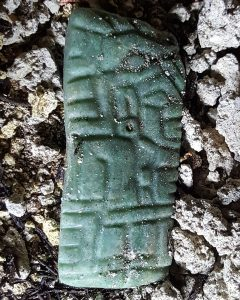 Jade carving of a ruler wearing a crocodile head (by The Guardian)