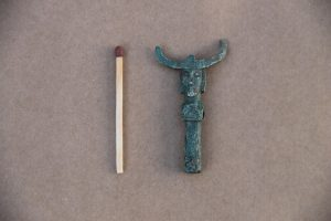 Odin figurine and a match for size comparison (by Vikinge Museet Ladby)