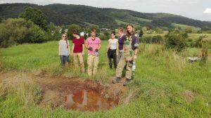 Archaeology students by a salt spring (by Maciej Dębiec)