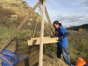 Sieving of earth at the site (by CBC News)
