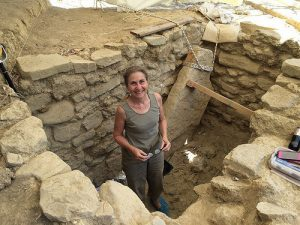 Excavated shaft tomb and archaeologist Sharon Stocker of UC (by Popular Archaeology)