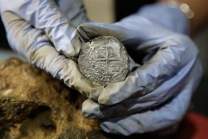 Silver coin recovered from the wreckage of the pirate ship (by AP)