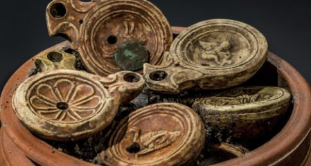 Roman-era pot filled with oil lamps and bronze coins discovered