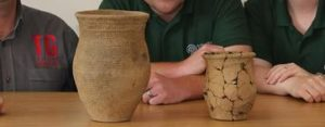 Archaeologists with the pottery (by Daily Post)