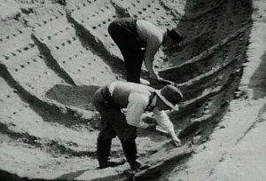 Archive footage showing the excavation of the boat burial and impression left by the decayed wood (by Harold John Phillips via Ars Technica)