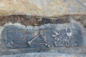 Burial with relocated bones (by Krzysztof Socha)