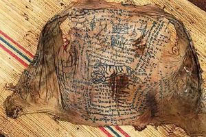 The tattoo of black magic spells (by Exclusivepix Media via Mirror Online)