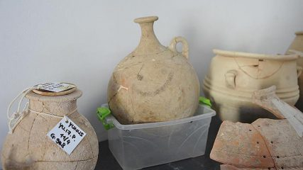 Ancient pot with a painted smiley-face found in Karkemish
