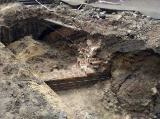 14th century wall discovered by construction workers