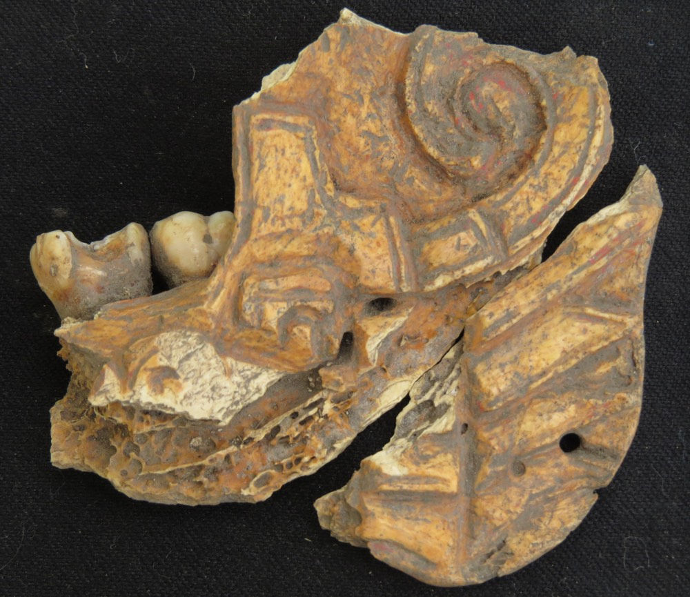 Ancient jewellery made of painted human jawbone found