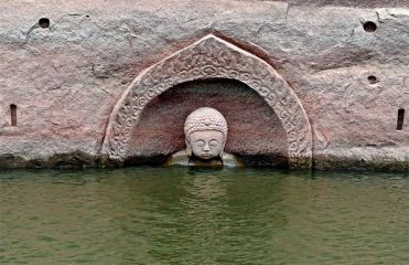 Ancient Buddha statue emerges from water reservoir
