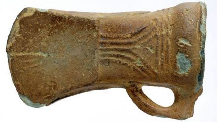 Ornamented bronze axe found in a stream