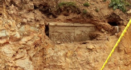 Road works unearth ancient sarcophagus