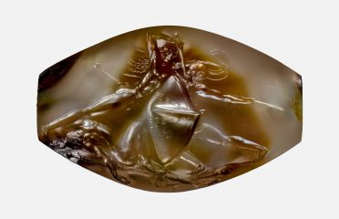 Lime-covered artefact reveals to be an engraved gemstone
