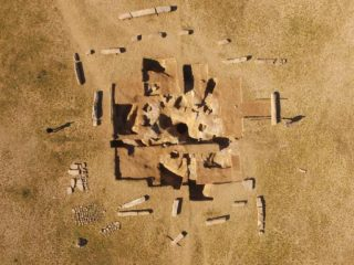 Monument surrounded by pillars discovered on steppe